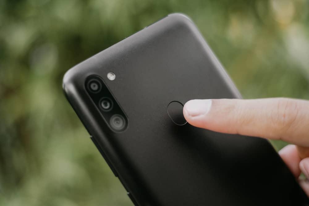 Black Samsung Galaxy M11 showing the fingerprint feature